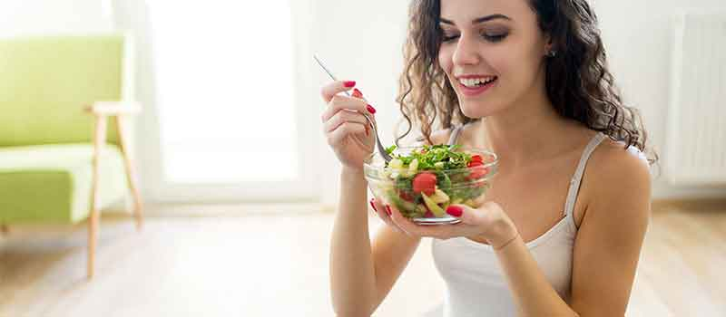 A girl eating a healthy salad