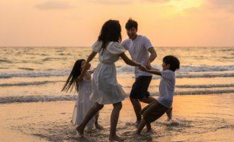 family enjoying vacation on a beach
