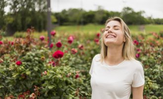woman standing in flower garden