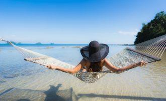 woman sitting in a hammock